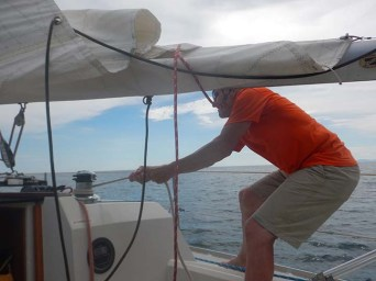 First Mate, Ken, raising the main sail.